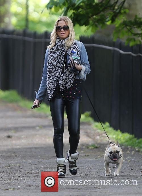 Sarah Harding takes her dog for a walk