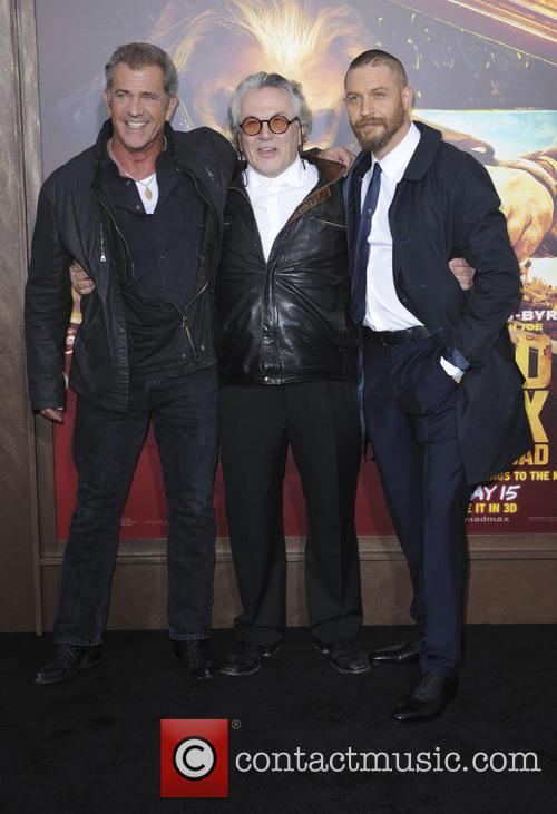 Mel Gibson poses for photos with George Miller and Tom Hardy