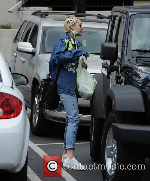 Miley Cyrus spotted out wearing a denim jacket...