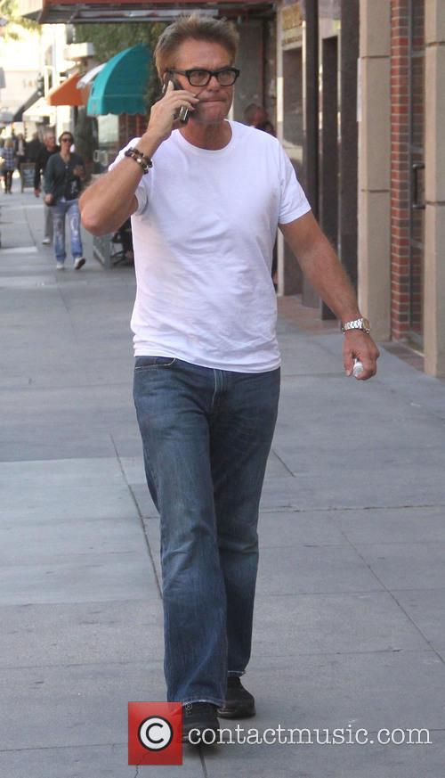 Harry Hamlin wearing sneakers after wearing a support...