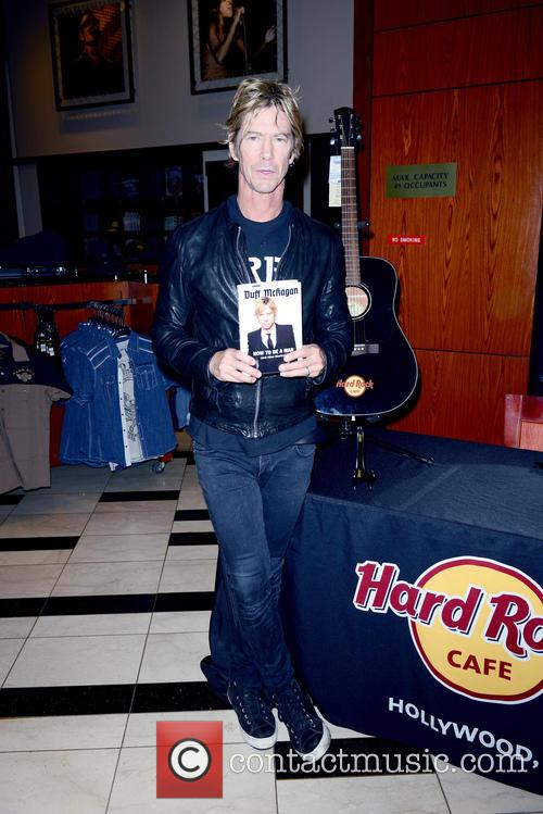 Guns N' Roses basssist Duff McKagan signs copies...