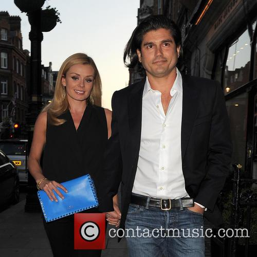 Katherine Jenkins shields her baby bump with a...