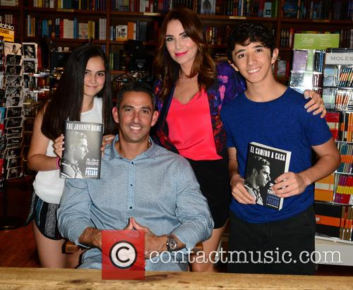 Jorge Posada signs copies of his book 'The...