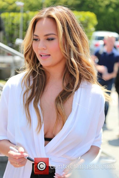 Chrissy Teigen appears on Extra