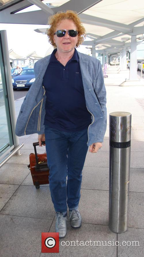 Mick Hucknell arrives at Heathrow airport