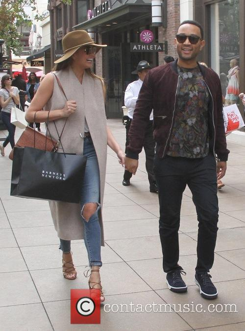 John Legend and Chrissy Teigen go shopping at...
