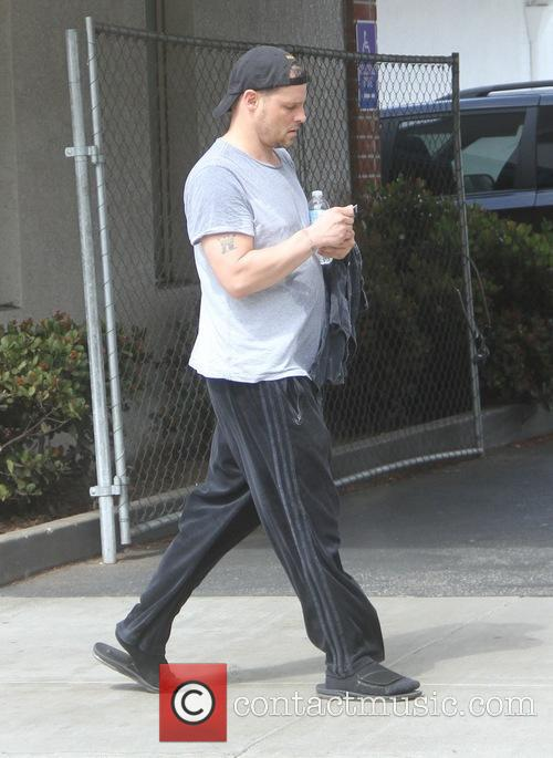Justin Chambers leaving a gym
