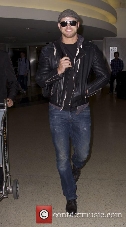 Kellan Lutz arrives at Los Angeles International (LAX)...
