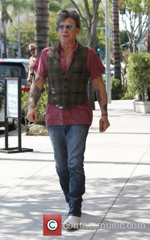 Mickey Rourke leaves Cafe Roma