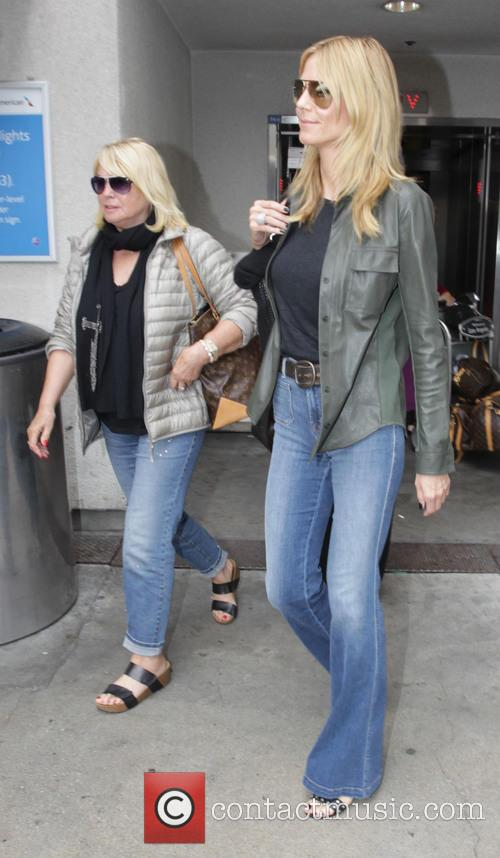Heidi Klum with her mom arrives at LAX...