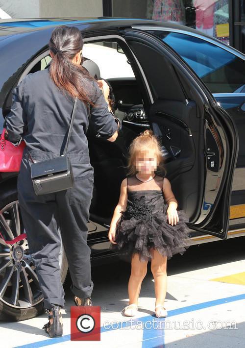 Kourtney Kardashian take her daughter Penelope to a...