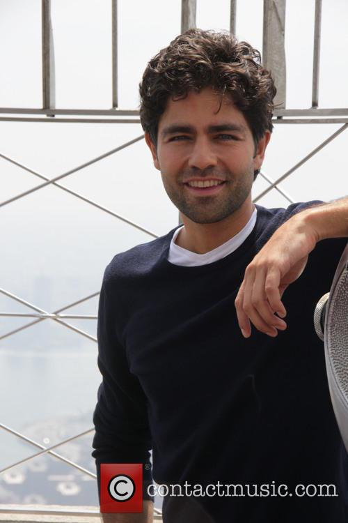Actor Adrian Grenier visits The Empire State Building...