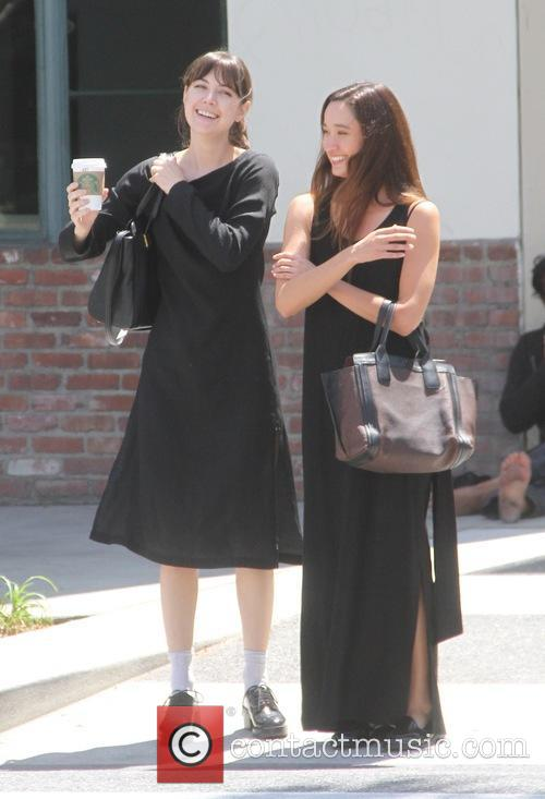 Aubrey Plaza laughing with a friend while out...