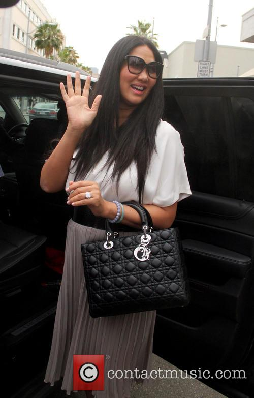 Kimora Lee Simmons takes her daughters out to...