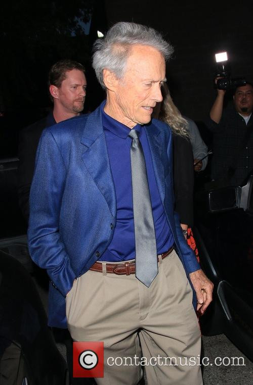 Clint Eastwood and his daughter Alison Eastwood leave...
