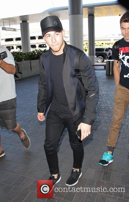 Nick Jonas arrives at Los Angeles International Airport...