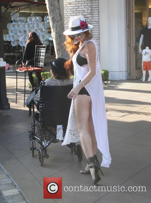Phoebe Price with her mother in a wheelchair
