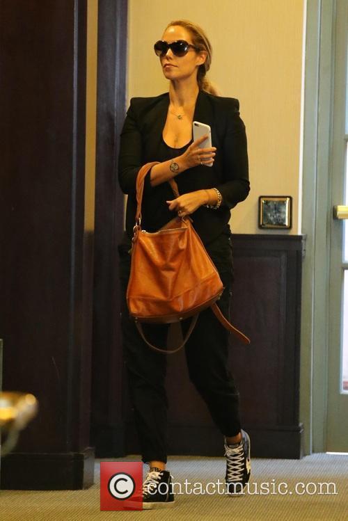 Elizabeth Berkley enters a medical building