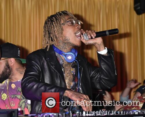 DJ Walshy Fire and Wiz Khalifa spin at...