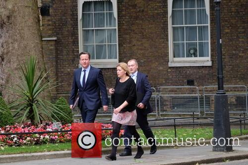 David Cameron walks up Downing st