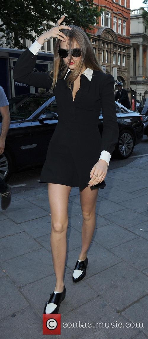 Cara Delevingne leaving her hotel wearing an all...