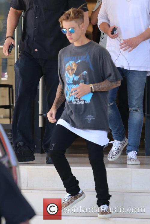 Justin Beiber leaves Barneys New York wearing a...