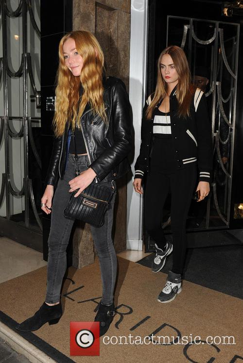 Cara Delevingne and Clara Paget leave their hotel...