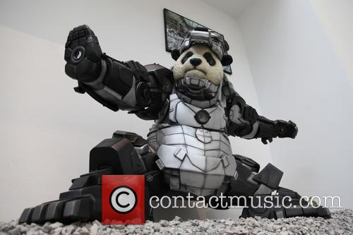 Giant Panda Statue In Iron Man Armor Protects...
