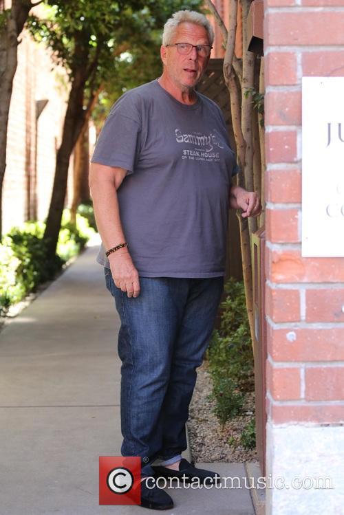 Steve Tisch uses an ATM in Beverly Hills