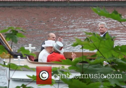 Queen Elizabeth II on a boat ride with...