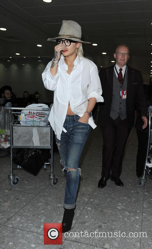 Rita Ora appears worn out, as she makes...