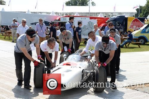 Honda Team Pushes One Of Their Cars 2