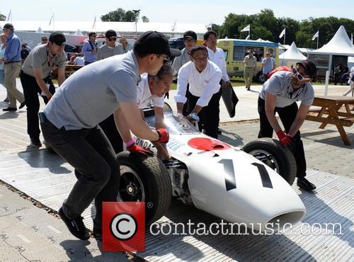 Honda Team Push One Of Their Cars 3