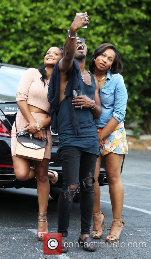 Christina Milian taking selfies with friends while out...