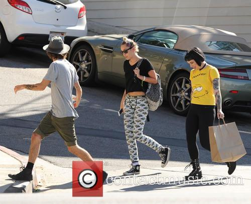 Miley Cyrus spotted out with friends after having...