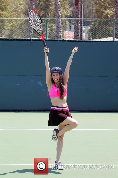 Phoebe Price and Alicia Arden playing Tennis