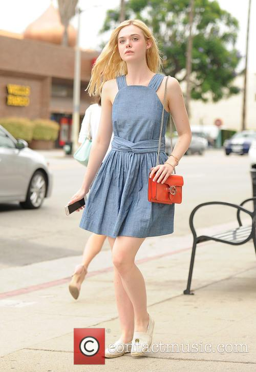 Elle Fanning wears a blue dress