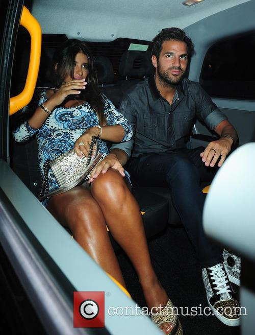 Heavily pregnant Daniella Semaan and Cesc Fabregas leaving...