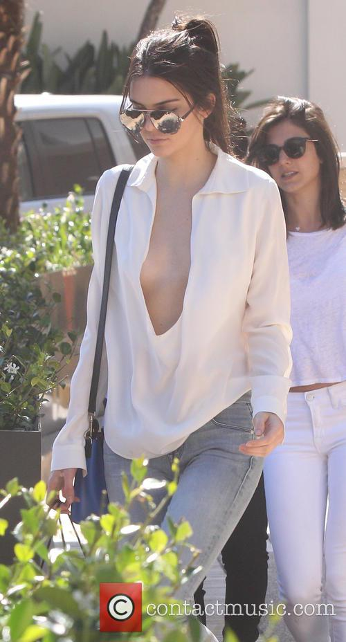 Kendall Jenner revealing her cleavage in a very...