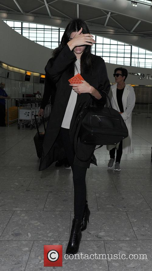 Kendall Jenner and Kris Jenner arrive at Heathrow...