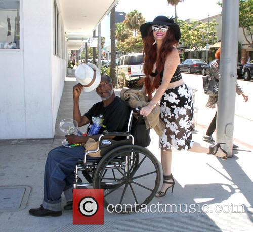 Phoebe Price chats to a man in a...