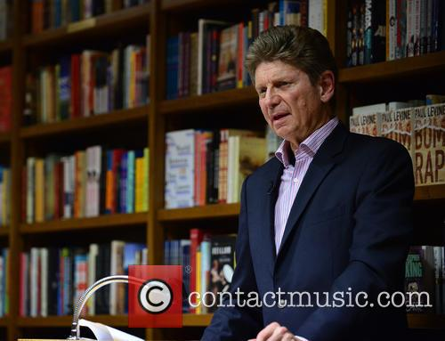Author Paul Levine attends a book signing and...