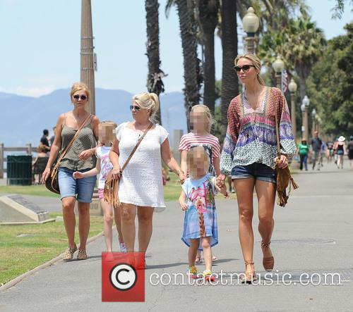 Alex Gerrard and family walk through Santa Monica...