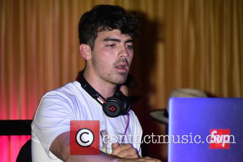 Joe Jonas DJing at 1AOK nightclub
