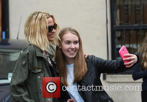 Sarah Harding posing for pictures with fans at...