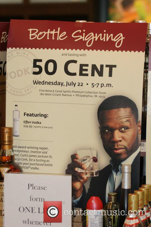 50 Cent signs bottles of Effen Vodka