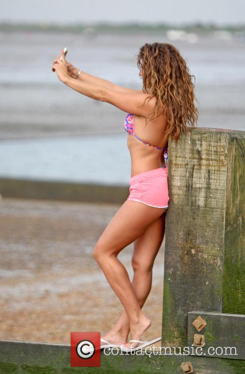 Pascal Craymer relaxes on a beach in Essex
