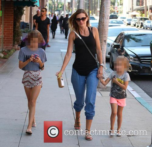 Rhea Durham and her daughters pick up juice...