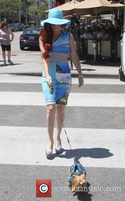 Phoebe Price takes her dog Henry for a...