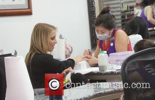 Jenn Berman has a manicure